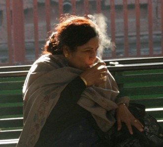 Indian woman at train station.