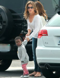 Jillian Micheal's, biggest loser trainer, courts paparazzi from her adoption of an African child,